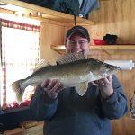 man shows big caught fish