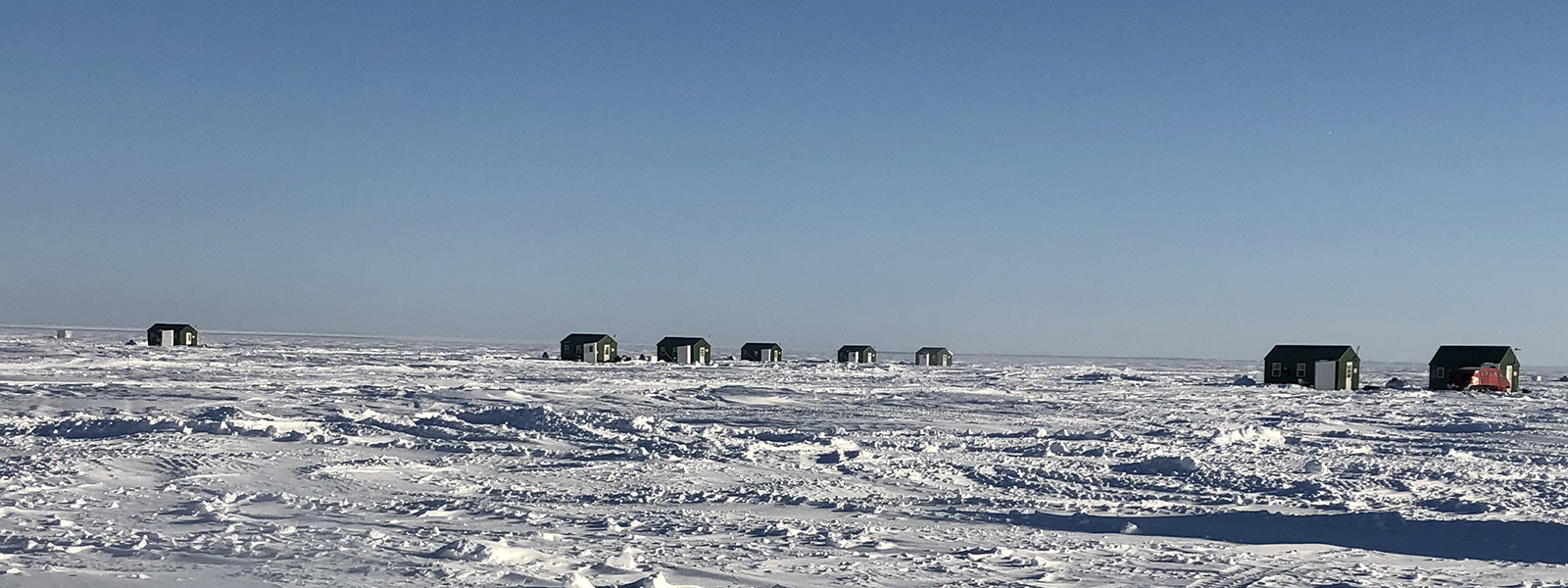 a row of ice houses on Lake of the Woods in MN