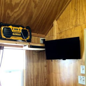 Inside fish house showing radio and v