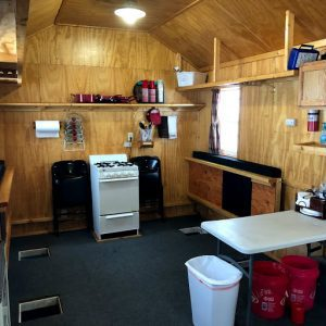 Inside a fish house showing a stove at Dale's on Lake of the Woods