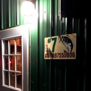 Dale's green #7 fish house sign and window
