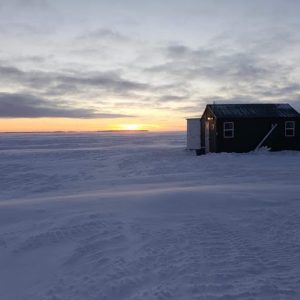 Fish house on Lake of the Woods at sunrise