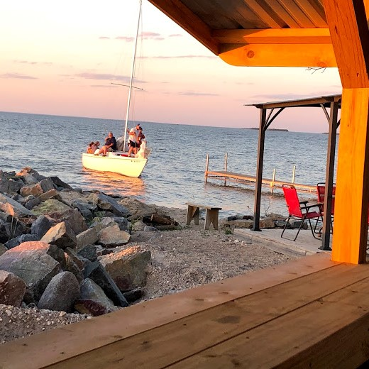 Camping guests bringing their sailboat back to the dock