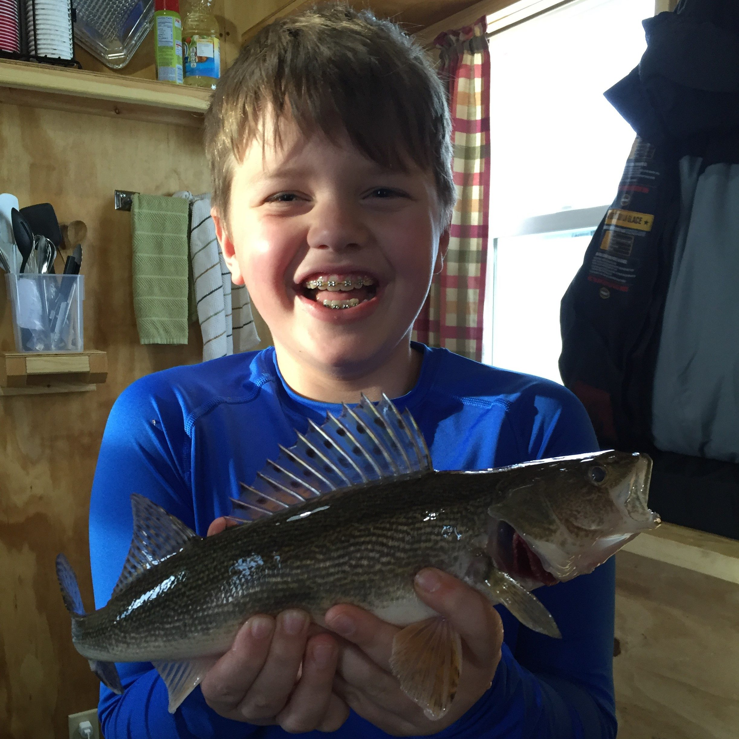Young Ice Fisherman with Fish